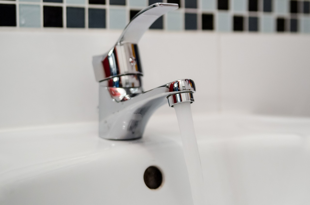 standing water article - image of running faucet